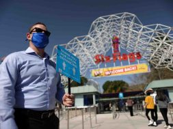 People enter Six Flags Magic Mountain amusement park on the first day of opening, as the coronavirus disease (COVID-19) continues, in Valencia